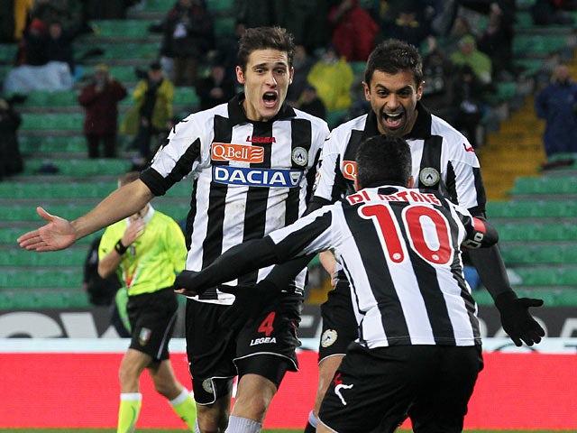 Udinese's Danilo Larangeira celebrates with team mates after scoring his team's third goal on December 2, 2012