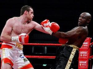 David Price throws a punch at Matt Skelton on December 1, 2012