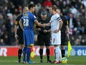 MK Dons' captain Dean Lewington and AFC Wimbledon's captain Steven Gregory shake hands moments before kick off on December 2, 2012