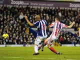 Dean Whitehead gets in front on Steven Reid to score against West Bromwich Albion on December 1, 2012
