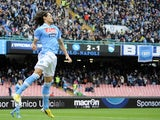 Napoli's Edinson Cavani celebrates after scoring against Pescara on December 2, 2012