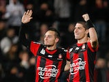 Nice's Eric Bautheac and Jeremy Pied celebrate their team's win over Paris Saint-Germain on December 1, 2012