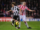 Fabricio Coloccini and Charlie Adam battle for the ball on November 28, 2012