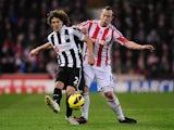 Fabricio Coloccini and Charlie Adam battle for the ball on November 28, 2012