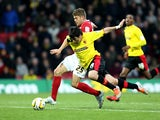 Watford's Fernando Forestieri and Barnsley's Martin Cranie battle for the ball on December 1, 2012