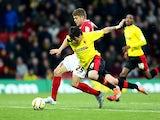 Watford's Fernando Forestieri and Barnsley's Martin Cranie battle for the ball on December 1, 2012