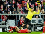 Bayern Munich's Franck Ribery and Borussia Dortmund's Lukasz Piszczek battle for the ball on December 1, 2012