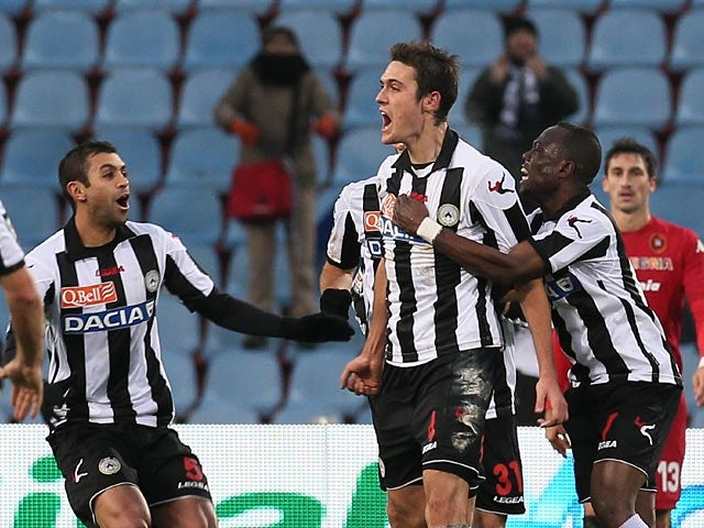 Udinese's Gabriele Angella celebrates with team mates after scoring his team's second goal on December 2, 2012