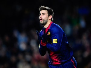 Pique's son gets first Barca kit