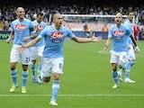 Napoli's Gokhan Inler celebrates scoring against Pescara on December 2, 2012