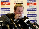 Thirsty Harry Redknapp has a drink from a cup on November 26, 2012