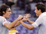 Lazio's Hernanes congraulates Giuseppe Biava after scoring the opener against Parma on December 2, 2012