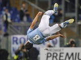 Hernanes jumps in the air after scoring for Lazio on November 27, 2012