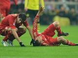 Holger Badstuber lies down injured on the pitch on December 1, 2012