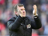 MK Dons manager Karl Robinson claps after the FA Cup match against AFC Wimbledon on December 2, 2012