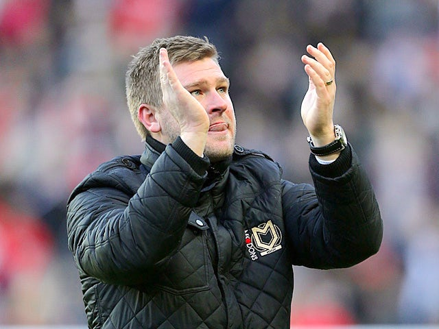Robinson satisfied with Dons point