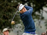 Keegan Bradley tees off at the second hole on November 29, 2012