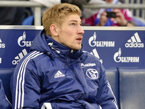 Schalke's Lars Unnerstall sits on the bench on December 1, 2012