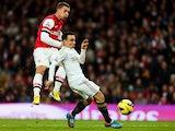 Leon Britton attempts to block Lukas Podolski's shot on goal on December 1, 2012