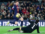 Barcelona's Lionel Messi scores the opener against Athletic Bilbao on December 1, 2012