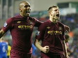 Maicon congratulates James Milner after scoring his team's second goal against Wigan on November 28, 2012