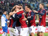 Bologna's Manolo Gabbiadini is congratulated by team mates after scoring the winner on December 2, 2012