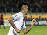 Napoli's Marek Hamsik celebrates his strike against Cagliari on November 26, 2012