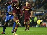 Mario Balotelli strikes to score the opener against Wigan on November 28, 2012