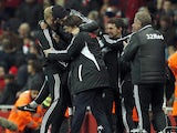 Michael Laudrup celebrates with his coaching staff after going 2-0 up against Arsenal on December 1, 2012