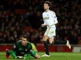 Miguel Michu slots the ball pass Wojciech Szczesny to score the opener on December 1, 2012