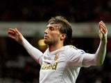 Miguel Michu celebrates after scoring his second goal on December 1, 2012