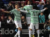 Mikael Lustig celebrates with team mates after scoring his team's second goal against Hearts on November 28, 2012