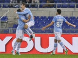 Miroslav Klose celebrates scoring for Lazio on November 27, 2012