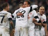 Mainz players celebrate after Nikolce Noveski scores on November 27, 2012