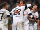 Mainz players celebrate after Nikolce Noveski scores on November 27, 2012