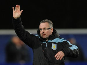 Lambert 'will keep Villa job'