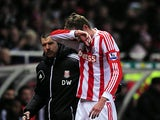 Peter Crouch is substituted after picking up an injury against Newcastle on November 28, 2012