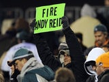 "A Philadelphia Eagles fan holds up a ""Fire Andy Reid"" sign on November 26, 2012"