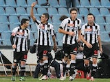 Udinese's Roberto Pereyra is congratulated by team mates after scoring the opener against Cagliari on December 2, 2012