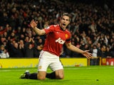 Robin van Persie celebrates scoring the first for United on November 28, 2012
