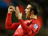 Robin Van Persie celebrates after scoring his team's fourth goal on December 1, 2012