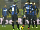 Inter forward's Diego Milito and Rodrigo Palacio kick-off following a Parma goal on November 26, 2012