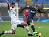 Inter Milan's Rodrigo Palacio and Palermo's Eros Pisano battle for the ball on December 2, 2012