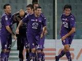 Stefan Savic celebrates with Fiorentina teammates on December 2, 2012