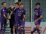 Stefan Savic celebrates with Fiorentina teammates on December 2, 2012