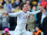 MK Dons' Stephen Gleeson celebrates after scoring the opener against AFC Wimbledon on December 2, 2012