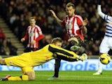 Sunderland's Steven Fletcher has his shot saved by QPR's Robert Green on November 27, 2012