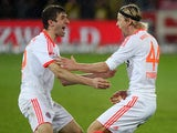 Anatoliy Tymoshchuk is congratulated by Thomas Mueller after scoring the second goal of the match against Freiburg on November 28, 2012
