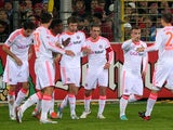 Thomas Mueller is congratulated by his team mates moments after scoring the opener on November 28, 2012