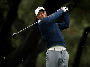 Woods shares lead at Cadillac Championship